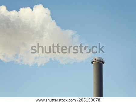 Industrial smoke from factory air stack pollution - stock photo