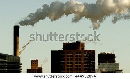 industrial smoke pollution raising over the city background