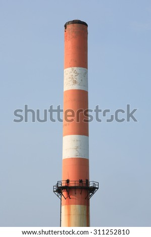 Industrial smoke stack and blue sky - stock photo