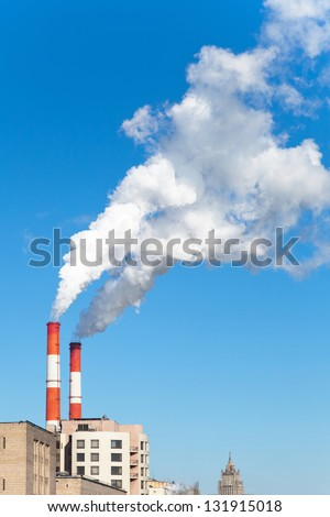 Industrial smoke stack of coal power plant in city - stock photo