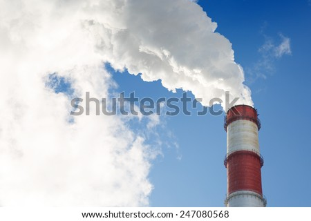 Industrial smoke stack with large white smoke cloud - stock photo