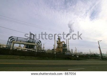 Industrial Smoke Stacks Emitting Smoke - stock photo