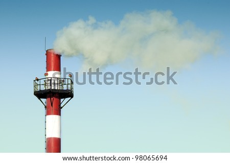 Industrial Smokestack Emitting Smoke into the Sky - stock photo