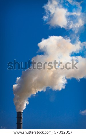 Industrial Smokestack On A Beautiful Summer Day