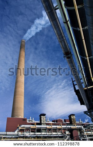 Industrial Stack at Nickel Plant with blue sky as background - stock photo