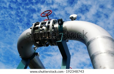 Industrial Steel pipelines and valves  against sky