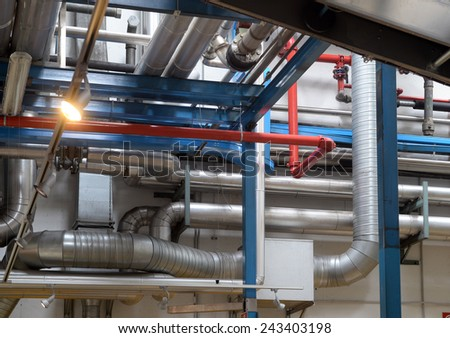 industrial steel pipes in production factory  - stock photo