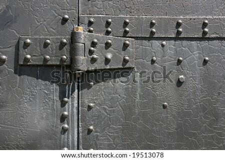 Industrial steel tin door texture. Metal hinge and bolts. - stock photo