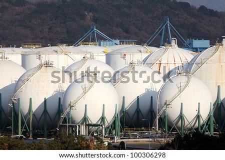 Industrial storage tanks in refinery - stock photo