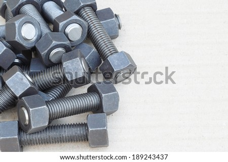 Industrial stud bolts on paper recycle background