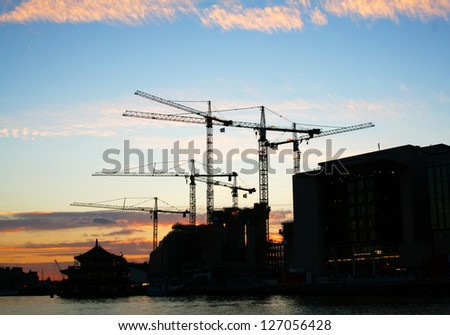 Industrial sunset on the river - stock photo