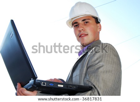 Industrial theme: constructor and laptop. - stock photo