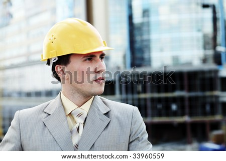 Industrial theme: constructor standing at a site area. - stock photo