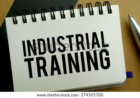 Industrial training memo written on a notebook with pen