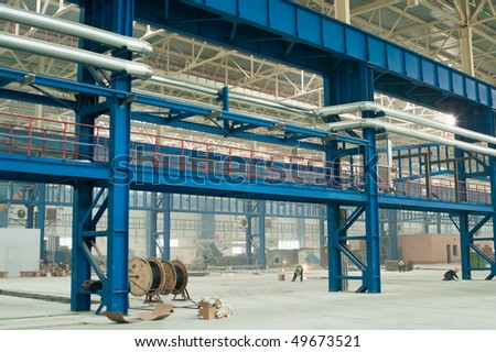 Industrial trunk pipelines on shop columns in factory