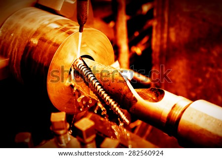 Industrial turning, threading machine at work close-up. Industry concept, red tone. - stock photo