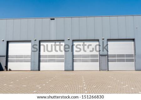 Industrial Unit with roller shutter doors  - stock photo