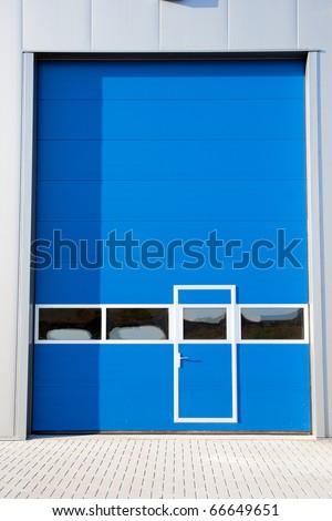 Industrial Unit with roller shutter doors - stock photo