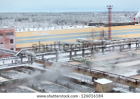 Industrial view of sewage treatment plant with evaporation in winter season - stock photo