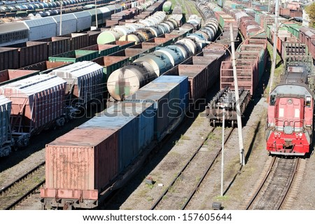 industrial view with lot of freight railway trains waggons - stock photo