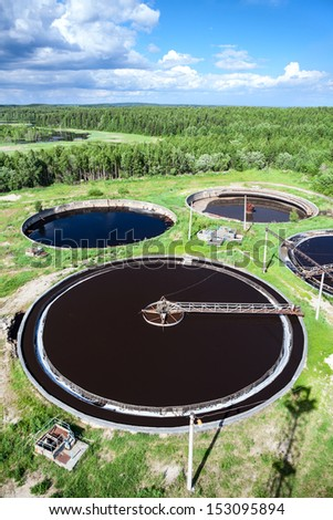 Industrial wastewater treatment plant in evergreen forest - stock photo