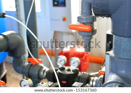 industrial water pipeline in a boiler room - stock photo