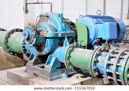 Industrial water pump and pipe  - stock photo