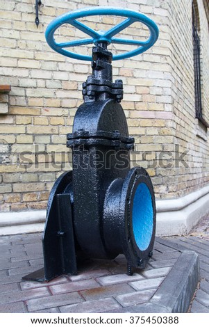 Industrial water tap exhibited to the public. Industry - stock photo