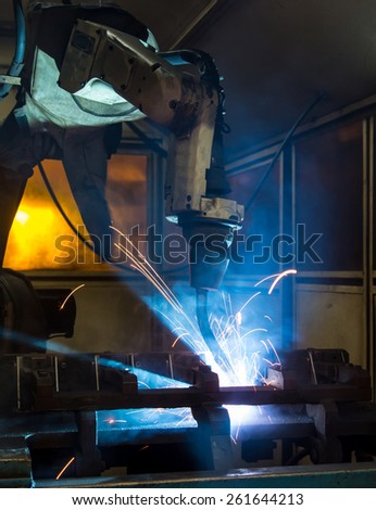 Industrial welder robotic in a car factory