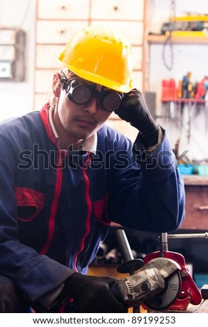 Industrial worker and his tools - stock photo