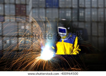 Industrial worker cutting and welding metal with many sharp sparks, - stock photo
