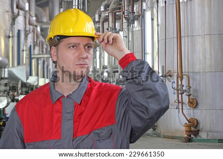 Industrial worker in a factory - stock photo