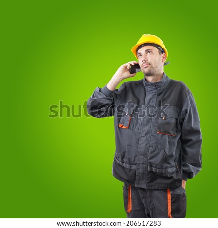 industrial worker in action on solid background