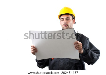 industrial worker in action on white background