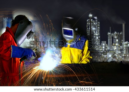 Industrial worker welding metal with many sharp sparks and worker during use electric wheel grinding  - stock photo