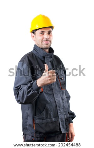 industrial worker with thumbs up on white background - stock photo