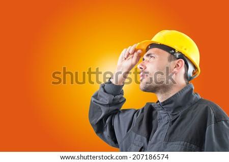 industrial worker with yellow helmet - stock photo