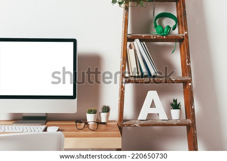 Industrial workspace with computer. / Closeup of minimal office on white background.