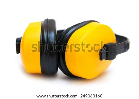 Industrial yellow protective headphones isolated on white background - stock photo