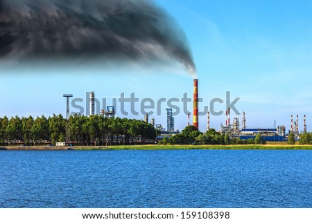 Industrial zone - Air pollution at a chemical factory. - stock photo