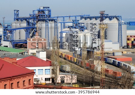 Industrial zone of Odessa sea cargo port with grain dryers,containers,cranes and storehouses,Black Sea,Ukraine