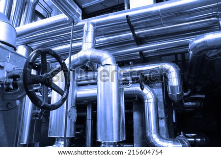 Industrial zone, oil and gas pipelines in a blue toning - stock photo