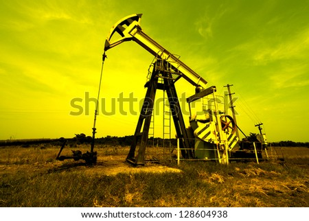Industrial zone, oil jack against sky - stock photo