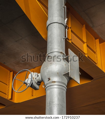 Industrial zone, Steel pipeline and valves against orange constructions