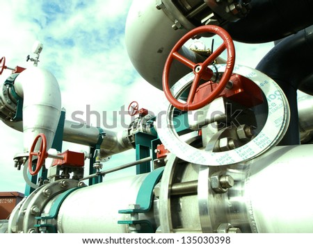 Industrial zone, Steel pipelines and cables in green tones - stock photo
