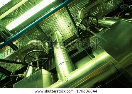 Industrial zone, Steel pipelines and equipment in green tone - stock photo