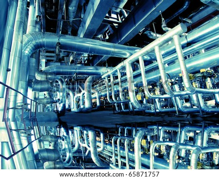 Industrial zone, Steel pipelines in blue tones with reflection