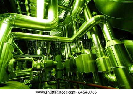Industrial zone, Steel pipelines in green tones - stock photo