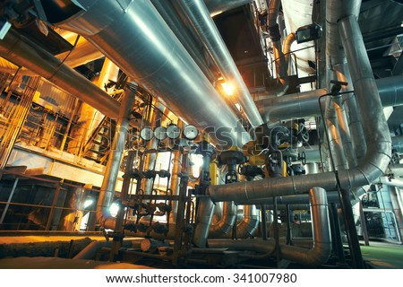 Industrial zone, Steel pipelines, valves and gauges - stock photo