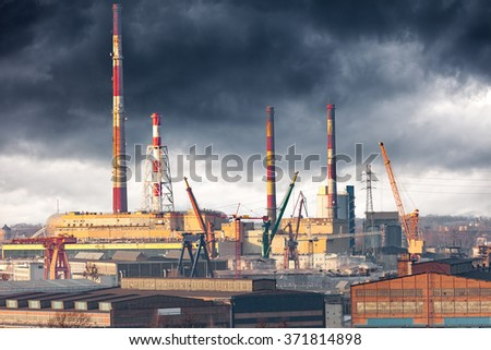 Industry area - CHP with high chimneys against dramatic sky. - stock photo